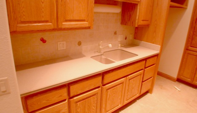 Corian like color Solid surface kitchen counter tops with towel bar by ...